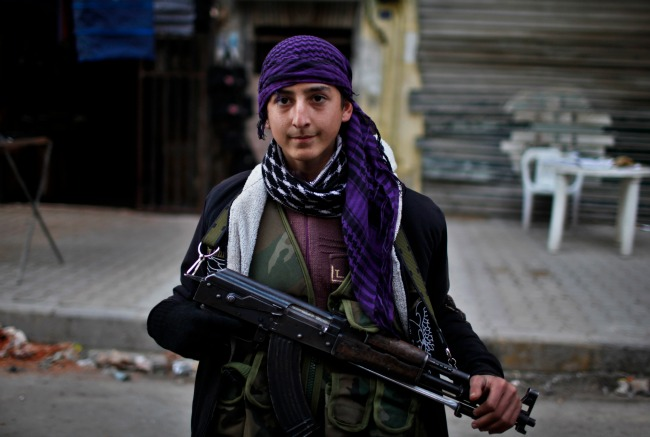 Armed young boy in the Syrian War